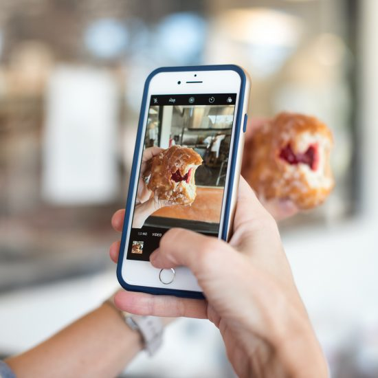Restaurant guest snapping picture for Instagram
