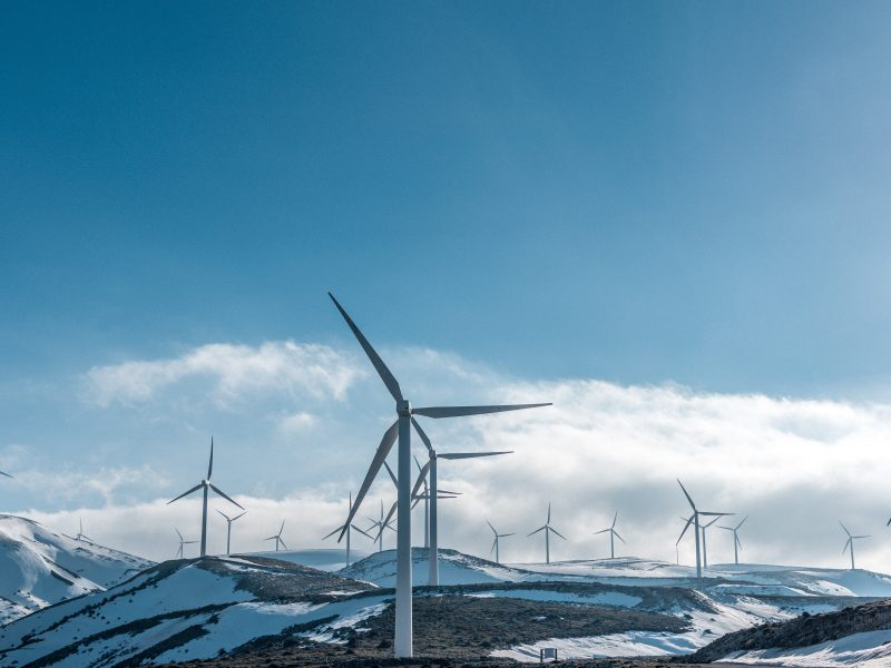clean energy wind turbines on a snowy surface